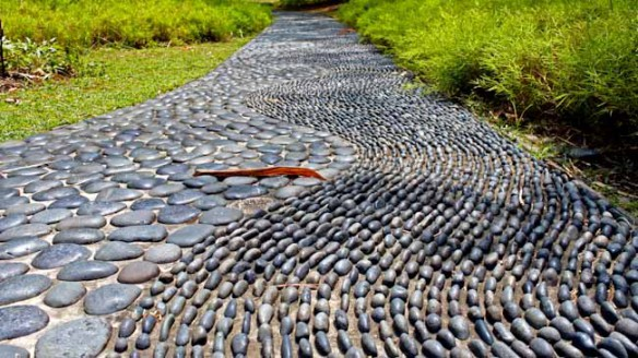 Stone Garden Path Ideas enhance your basic gravel path by adding brick shaped stones on each side of the path this idea allows you to accentuate the edges of the path to give it With The Deep Gray And Blue Colored Stones And Pebbles Implanted This Garden Path Idea Is Amazing Just Walk On It Barefoot And It Will Do An Acupuncture
