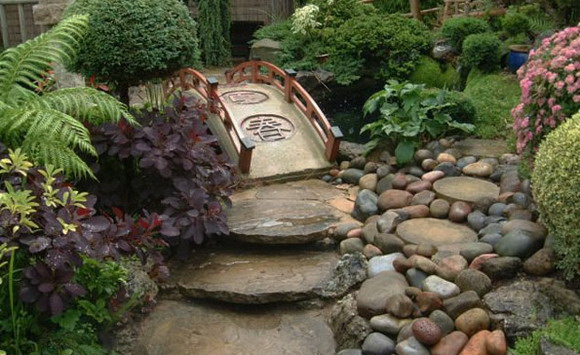 Backyard Path Ideas creative garden path designs with beach pebbles Look At This Japanese Garden Path Rocks Colorful Stones And Small Bridge Everything Is Complimenting Each Other And Giving The Place A Serene Ambiance