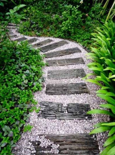 Exposed wooden plank to step on, white color road metal with mixture of  greenery, try this terrific garden pathway idea to create a mesmerizing  garden.