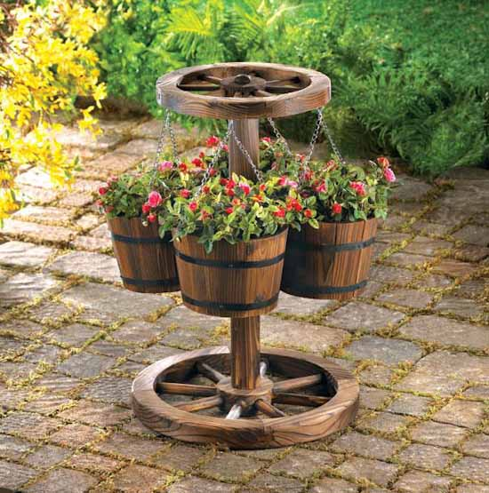 Garden Décor Items Embellish A Garden. You Can Buy Cool Planters, Whimsical  Sculptures, And Accessories For Her. *Look At This Amazing Wagon Wheel  Planter.