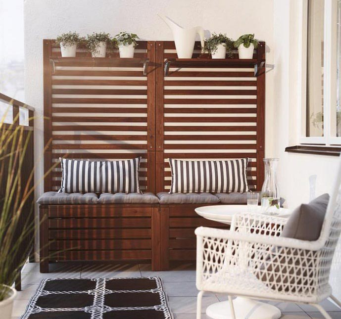 Use multi-functional furniture in your balcony. This wooden box can  accommodate accessories and garden tools inside and additionally will serve  as a seat.