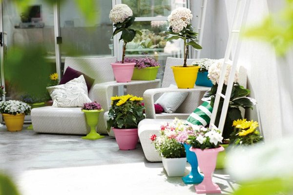 bright and colorful plastic planters of different sizes and shapes are in fashion create vivacious look using them other benefit of plastic planters is - Patio Flower Ideas