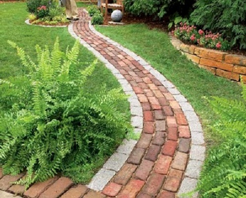 Design of this garden path is easy to imitate as these clinker bricks are  arranged in similar pattern and order. brick garden ideas