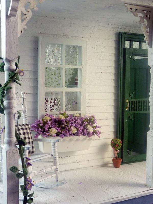 This Lovely Front Porch With A Rocking Chair Becomes More Lively And Good  Looking In Appearance Due To The Window Box Filled With Flowers.