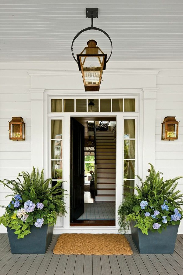 Porch Design Ideas this wrap around porch has green decking and white railings with country style charm Patio Design Ideas 2