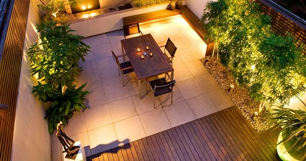 During the evening, it is important that your rooftop garden is well-lit.  Especially near the stairwell or door, it's nice to make more bright spots.