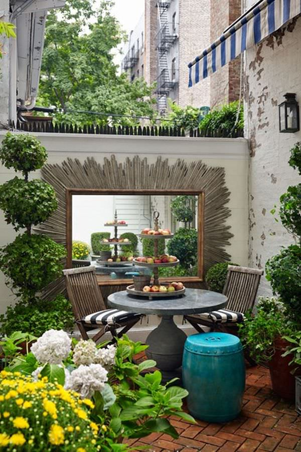 Although small, this rooftop garden is totally unique and appealing with  the addition of two interesting things: The ivy topiary and a large mirror,  ...