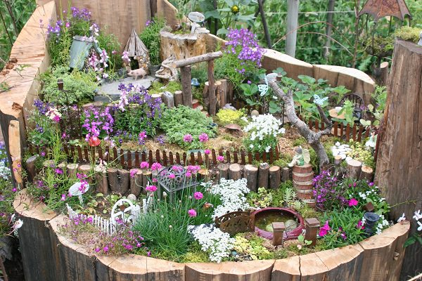 10 Amazing Tree Stump Ideas for the Garden | Balcony Garden Web on herb garden under tree, idea for plant around tree, yoga under tree, lighting under tree, books under tree, patio under tree, composting under tree, perennial gardens under tree, plants under tree, annuals under tree, wood under tree, woman under tree, under the tree, roses under tree, home under tree, girl under tree, flowers under tree, container garden under tree, decorating under tree, buddha under tree,