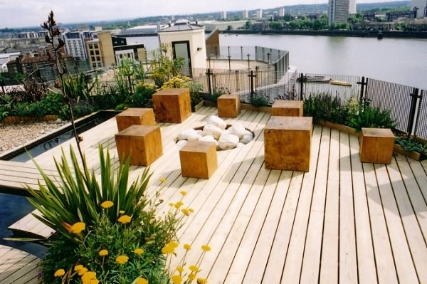 Choose flooring type that fits your budget, suits the climate you live in  and accommodate the theme of the rooftop garden.