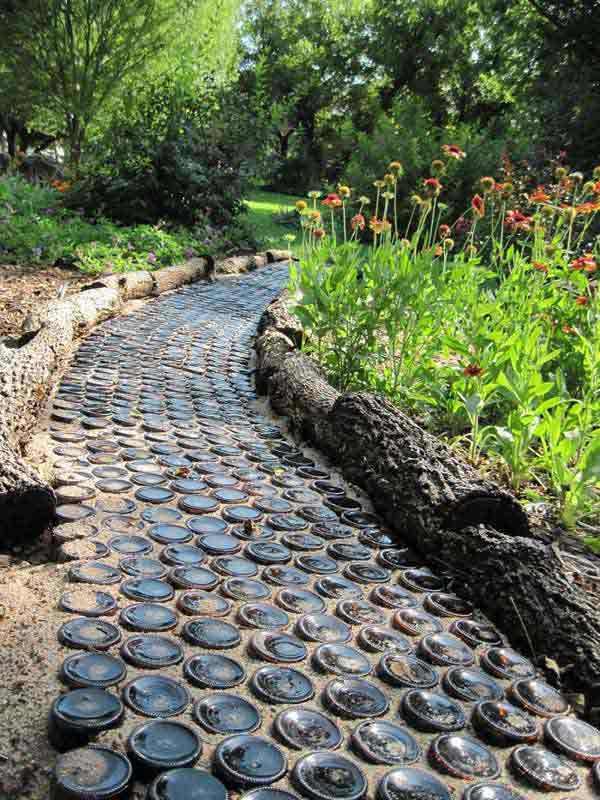 Diy wine bottle ideas for the garden 26 wine bottle uses for What does a garden designer earn