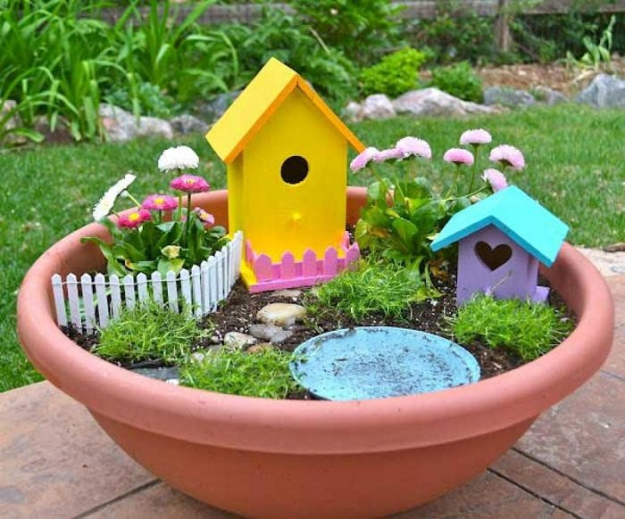 the focal point of this little fairy garden are the birdhouses place one or two birdhouses in a small pot and after that lay out the fence - Small Garden Ideas Kids