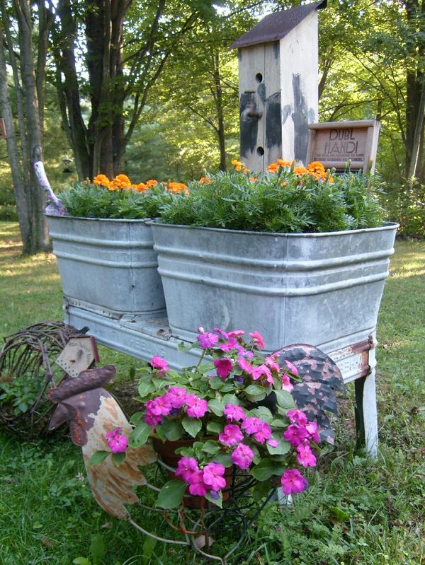 recycle old stuff that you have at home look at this idea planters made from old wash tubs here you can see more planter ideas from household items