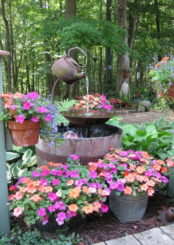 the use of a rustic looking teapot adds a completely new dimension to the garden you can also do something like this making a teapot water fountain like
