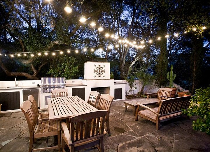 4 lovely budget patio ideas for small backyards balcony garden web invest in plenty of string lights solutioingenieria Choice Image