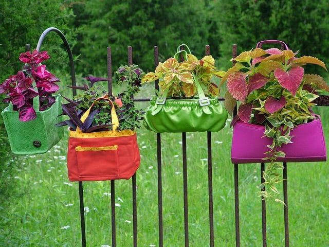 repurpose old and damaged purses into a beautiful hanging garden keep the plants in their pots so you can easily slip them out to drain excess moisture