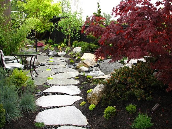 stone paths are ideal if you want to add more naturalness to your garden they come in different sizes and texture and so each stone is unique