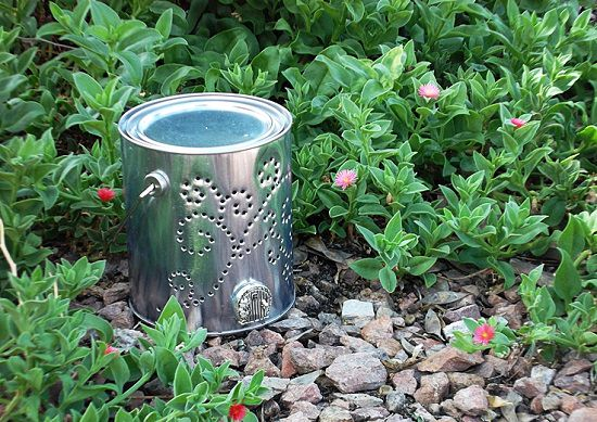 31 diy garden ornaments projects to beautify your garden balcony turn a quart sized paint can into a beautiful fairy house luminaria to display in your garden to know more check out the tutorial here solutioingenieria Image collections